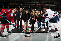 KELOWNA, CANADA - MARCH 9:  Nolan Foote #29 of the Kelowna Rockets and Jermaine Loewen #32 of the Kamloops Blazers take part in the ceremonial face-off with Cindy Cherry on March 9, 2019 at Prospera Place in Kelowna, British Columbia, Canada.  (Photo by Marissa Baecker/Shoot the Breeze)