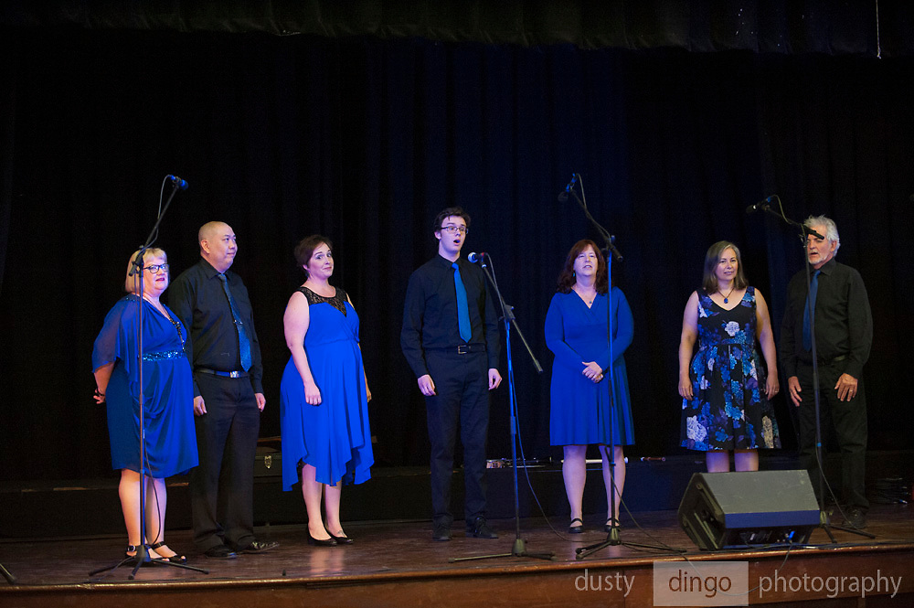 Merry Din 7 choir onstage in the Guildford Town Hall, part of the 2018 Guildford Songfest