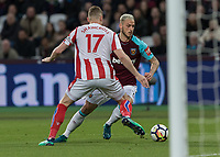 Football - 2017 / 2018 Premier League - West Ham United vs Stoke City<br /> <br /> Marko Arnautovic (West Ham United)  takes on his old team mate Ryan Shawcross (Stoke City) at the London Stadium<br /> <br /> COLORSPORT/DANIEL BEARHAM