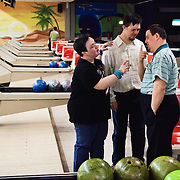 Marzia, Marco and Emilio discussing during a bowling training. The majority of people with Down syndrome can get a good level of personal autonomy.