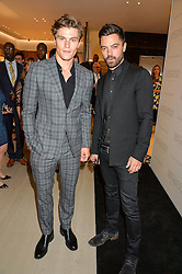 Left to right, OLIVER CHESHIRE and DOMINIC COOPER at a party to celebrate the launch of the new Watches of Switzerland Knightsbridge store 47-51 Brompton Road, London on 7th July 2016.