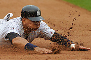 New York Yankees' Alex Rodriguez slides into third base on a double by Andruw Jones in the fourth inning of a baseball game against the Baltimore Orioles at Yankee Stadium in New York. (AP Photo/Kathy Kmonicek)