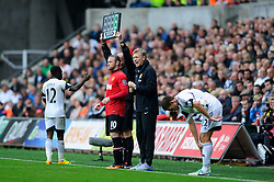 Man Utd Manager David Moyes (SCO) prepares to bring on Forward Wayne Rooney (ENG) during the second half of the match - Photo mandatory by-line: Rogan Thomson/JMP - Tel: Mobile: 07966 386802 17/08/2013 - SPORT - FOOTBALL - Liberty Stadium, Swansea -  Swansea City V Manchester United - Barclays Premier League - First round of the 2013/14 season and the first league match for new Man Utd manager David Moyes.