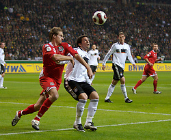 FRANKFURT, GERMANY - Wednesday, November 21, 2007: Wales' David Edwards and Germany's Gonzalo Castro during the final UEFA Euro 2008 Qualifying Group D match at the Commerzbank Arena. (Pic by David Rawcliffe/Propaganda)