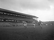 Derry kicks the ball flying towards the goal during the All Ireland Senior Gaelic Football final Dublin vs Derry in Croke Park on 28th September 1958. Dublin 2-12 Derry 1-9.