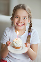 Portrait of a young girl with cupcake