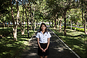 Thararat Panya stands in the grounds of Thammasat University where she is in her fourth year of a law degree. She was the victim of sexual assault by a fellow male student and bravely reported to the University and now speaks openly about her experience.