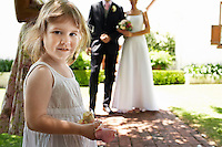 Flower Girl Holding Petals