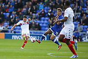 Tim Chow of Wigan Athletic tries a shot under pressure from Lee Erwin of Oldham Athletic during the EFL Cup match between Oldham Athletic and Wigan Athletic at Boundary Park, Oldham, England on 9 August 2016. Photo by Simon Brady.