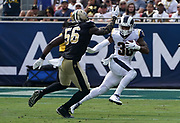 Los Angeles Rams running back Todd Gurley (30) runs with the ball while New Orleans Saints outside linebacker Demario Davis (56) defends during an NFL football game, Sunday, Sept. 15, 2019, in Los Angeles. The Rams defeated the Saints 27-9. (Dylan Stewart/Image of Sport)
