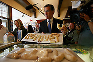 Republican presidential hopeful and former Massachusetts Governor Mitt Romney eats a Dutch letter during a campaign stop at Jaarsma Bakery in Pella, Iowa June 30, 2007.