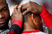 Boston Red Sox' David Ortiz, left, holds Mookie Betts' head as he congratulates him in the dugout after his two-run home run in the fifth inning of a baseball game against the Kansas City Royals at Kauffman Stadium in Kansas City, Mo., Sunday, June 21, 2015. The Red Sox beat the Royals 13-2. (AP Photo/Colin E. Braley)