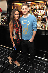 TYRONE WOOD and ROXIE NAFOUSI at a brunch hosted by Zac Posen to launch the Belvedere Bloody Mary Brunch held at Le Caprice, 25 Arlington Street, London on 7th April 2011.