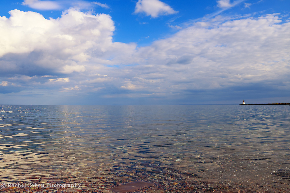 &quot;Spirit Glide in Blue&quot;<br /> <br /> Blue skies with puffy white clouds and calms waters of Lake Superior in Marquette Michigan!