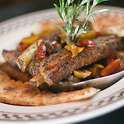 12/17/10 Wilmington DE: Pork Ribs with Vinegar Peppers served with garlic, rosemary, spicy vinegar pepper and white wine only at Anthony's Coal Fired Pizzas in Wilmington Delaware.<br /> <br /> Special to The News Journal/SAQUAN STIMPSON