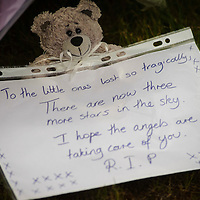 EDINBURGH, UK - 5th August 2010:  Police in Edinburgh are continuing the forensic examination of a flat on Edinburgh's Slateford Road after three children at the centre of a custody battle were discovered dead at the premises.  The grim discovery came after emergency services were called out to the house following reports of a gas explosion just before 3pm yesterday. Pictured a note is left amongst flowers at the scene. (Photograph: Callum Bennetts/MAVERICK)