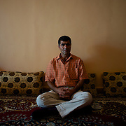 August 12, 2012 - Kafa Safra, Efrin, Syria: A ex-Kurdistan Workers' Party (PKK) fighter, Rouge, sits at his home in Kafa Safra. Rouge, now a Kurdish language teacher, spent 10 years in a Turkish prison after being capture during combat...PKK has been fighting an armed struggle against the Turkish state for an autonomous Kurdistan and greater cultural and political rights for the Kurds in Turkey, Iraq, Syria and Iran. Founded on 27 November 1978 in the village of Fis, was led by Abdullah Öcalan. The PKK's ideology was originally a fusion of revolutionary socialism and Kurdish nationalism - although since his imprisonment, Öcalan has abandoned orthodox Marxism. The PKK is listed as a terrorist organization by Turkey, the United States, the European Union and NATO. (Paulo Nunes dos Santos)