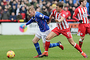Carlisle United Nicky Adams and Accrington Stanley Sean McConville battle during the EFL Sky Bet League 2 match between Accrington Stanley and Carlisle United at the Fraser Eagle Stadium, Accrington, England on 21 January 2017. Photo by Pete Burns.