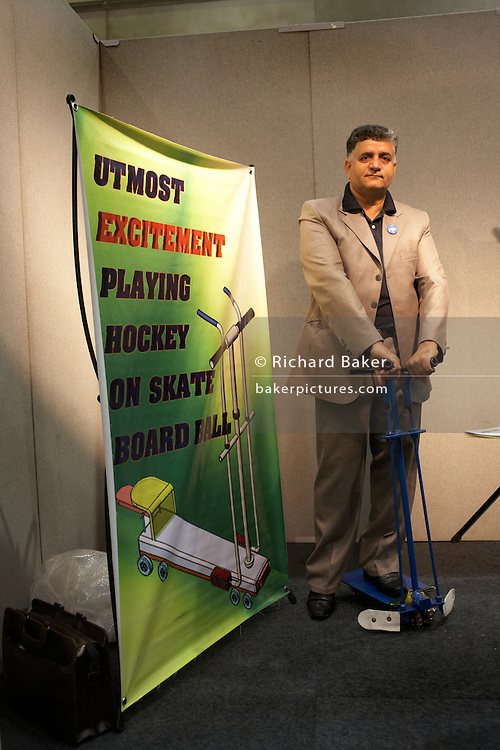 A new hockey concept is demonstrated by an entrepreneur at an inventors fair in Alexandra Palace, London