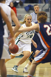 10 January 2009: Holly Harvey moves the ball around the perimeter. The Lady Titans of Illinois Wesleyan University downed the and Lady Thunder of Wheaton College by a score of 101 - 57 in the Shirk Center on the Illinois Wesleyan Campus in Bloomington Illinois.