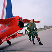 Pilot of the Red Arrows, Britain's RAF aerobatic team performs a pre-flight check before training flight.