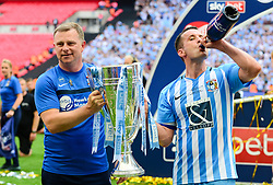 Free to use courtesy of Sky Bet. Michael Doyle of Coventry City and Coventry City manager Mark Robins celebrates with the Sky Bet League Two play-off trophy - Mandatory by-line: Dougie Allward/JMP - 28/05/2018 - FOOTBALL - Wembley Stadium - London, England - Coventry City v Exeter City - Sky Bet League Two Play-off Final