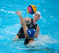 London, England, 05-05-12. Fran LEIGHTON (GBR) takes a shot while Bianka POCSI (HUN) defends during the Great Britain v Hungary game  in the VIsa Water Polo Invitational. Part of the London Prepares Olympic preparations.