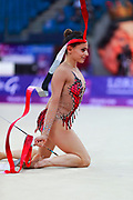 Ashram Linoy during qualifying at ribbon in Pesaro World Cup at Adriatic Arena on April 15, 2018. Linoy  is an Isrlaelian rhythmic gymnastics athlete born on May 13,1999 in Tel Aviv. Her targhet is to win Israel's first Olympic rhythmic gymnastics medal at the 2020 Olympic Games in Tokyo.