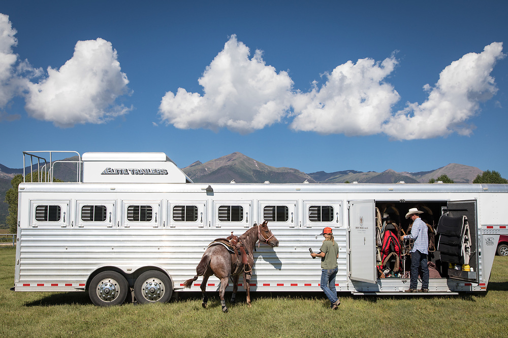 Grooms prepare a horse for action in the 2017 Sangre de Cristo Summer Classic cutting horse competition in Westcliffe, CO.
