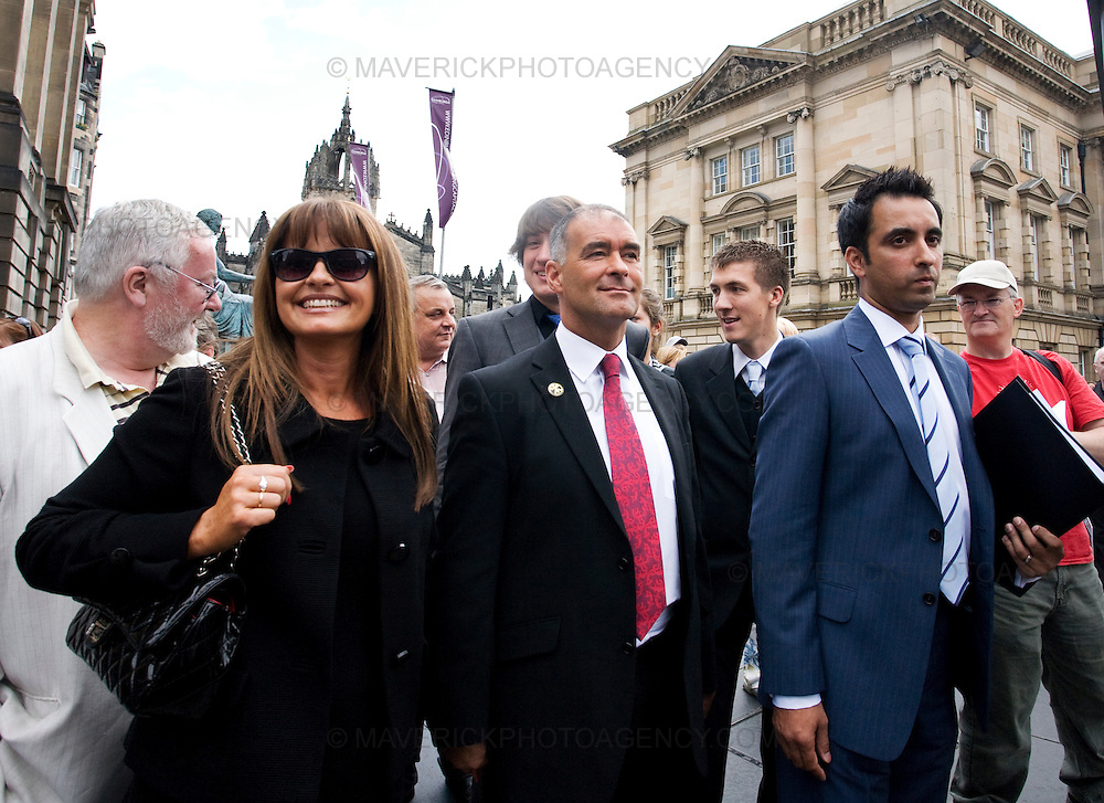 Former Socialist MSP Tommy Sheridan and his wife Gail leave Edinburgh High Court with his lawyer Amar Anwar where Tommy  is facing perjury charges....Picture Michael Hughes/Maverick.