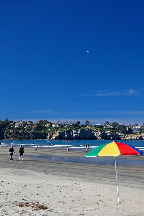 USA, California, La Jolla. La Jolla Shores Beach and umbrella in San Diego.