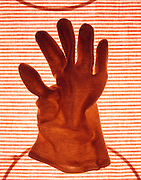 still life of a cotton glove on striped background