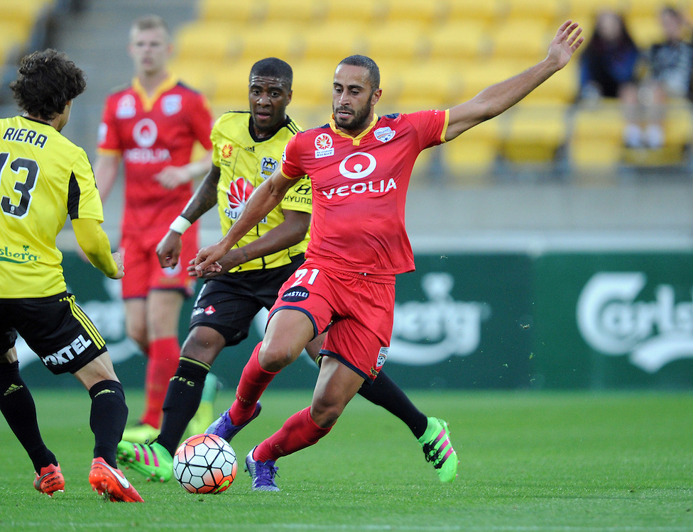 Adelaide United's Tarek Elrich, right, plays around Phoenix's Albert Riera in the A-League football match at Westpac Stadium, Wellington, New Zealand, Saturday, March 05, 2016. Credit:SNPA / Ross Setford