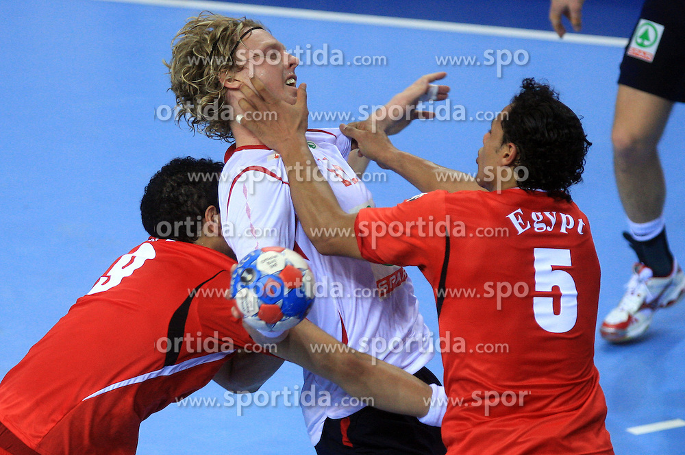 Amr El Kalioby (9) and Moustafa Hussein of Egypt (5) vs Erlend Mamelund of Norway during 21st Men's World Handball Championship preliminary Group D match between Norway and Egypt, on January 19, 2009, in Arena Zatika, Porec, Croatia. Win of Norway 30:20.(Photo by Vid Ponikvar / Sportida)