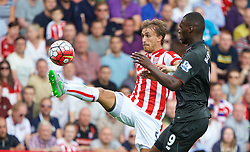 STOKE-ON-TRENT, ENGLAND - Sunday, August 9, 2015: Liverpool's Christian Benteke in action against Stoke City's Marc Muniesa during the Premier League match at the Britannia Stadium. (Pic by David Rawcliffe/Propaganda)