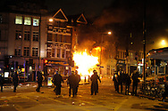 Riot Police at Clapham Junction after Party Superstore set alight by rioters during a night of rioting at Clapham junction South London