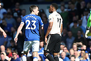 Everton defender Seamus Coleman (23) lets Manchester United forward Anthony Martial (11) know what he thinks about the latter going down too easily in the box looking for a penalty during the Premier League match between Everton and Manchester United at Goodison Park, Liverpool, England on 21 April 2019.