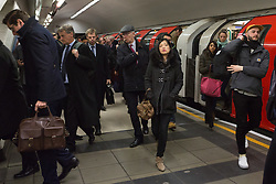 "© Licensed to London News Pictures. 18/01/2016. Commuters on the busy Waterloo and City tube line this morning. London, UK. Today, known as ""Blue Monday"" is meant to be the most depressing day of the year. Photo credit : Vickie Flores/LNP"