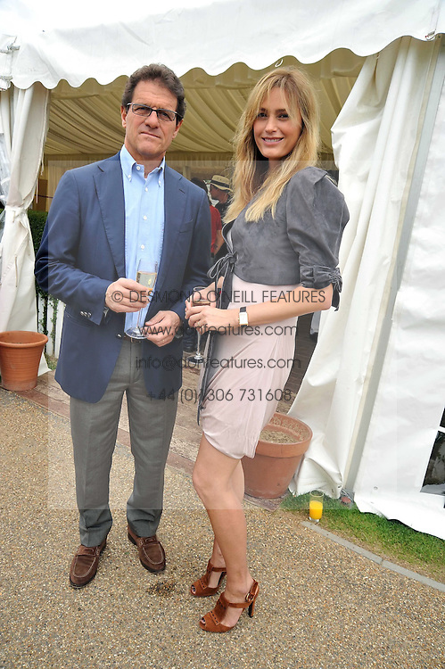 England football manager FABIO CAPELLO and YASMIN LE BON at a charity polo match organised by Jaeger Le Coultre was held at Ham Polo Club, Richmond, Surrey on 12th June 2009.