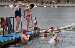 © under license to London News Pictures. 25/12/10. Members of the Serpentine Swimming Club brave ice and freezing temperatures to take part in their annual Christmas day swim in Hyde Park, London. Fortified with hot drinks swimmers take to the icy waters of the Serpentine. Credit should read Matt Cetti-Roberts/London News Pictures