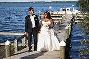 Bride and groom walking up a dock on Seneca Lake on their wedding day held at Belhurst Castle in Geneva, NY in the Finger Lakes