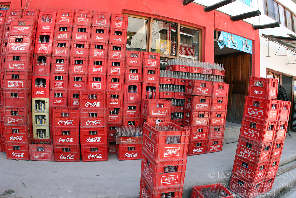 Coke bottles stacked outside a store in Machu Picchu Pueblo / Aguas Calientes, Peru