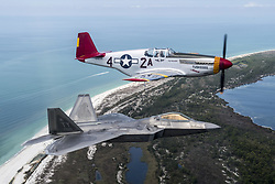Apr 22, 2017 - Tyndall Air Force Base, Florida, United States - Heritage Flight. An Air Force F-22 Raptor flies in formation with a World War II-era P-51 Mustang over Panama City Beach, Fla., April 22, 2017, as part of the opening ceremony of the Gulf Coast Salute Air Show. Air Force photo by Staff Sgt. Jason Couillard. (Credit Image: ? Staff Sgt. Jason Couillard/DoD via ZUMA Wire/ZUMAPRESS.com)