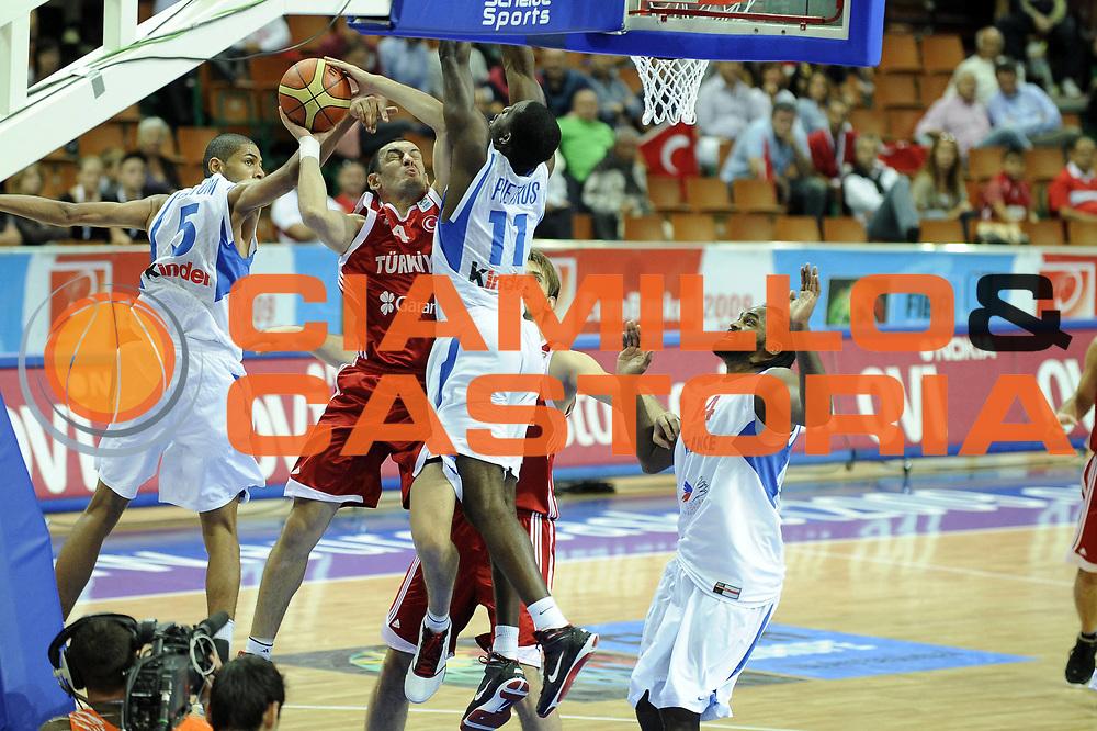 DESCRIZIONE : Katowice Poland Polonia Eurobasket Men 2009 Semifinal 5-8 place Francia France Turchia Turkey <br /> GIOCATORE : Bekir Yarangume<br /> SQUADRA : Turchia Turkey<br /> EVENTO : Eurobasket Men 2009<br /> GARA : Francia France Turchia Turkey <br /> DATA : 19/09/2009 <br /> CATEGORIA :<br /> SPORT : Pallacanestro <br /> AUTORE : Agenzia Ciamillo-Castoria/G.Ciamillo<br /> Galleria : Eurobasket Men 2009 <br /> Fotonotizia : Katowice  Poland Polonia Eurobasket Men 2009 Semifinal 5-8 place Francia France Turchia Turkey <br /> Predefinita :