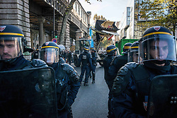 October 31, 2016 - Paris, France - Confrontation between migrants and French police after the evacuation of a small camp in the streets of Paris, France on 31 October 2016. More migrants and refugees coming from the dismantling of Calais and also from Italy are living in the streets of Paris, between the Stalingrad and Jaures tube Stations, in the north of the French capital. The police evacuates one of the camp, with migrants from Afgahnistan and Pakistan. (Credit Image: © Guillaume Pinon/NurPhoto via ZUMA Press)