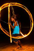 Fire dancer twirling fire, Mirissa Beach, south coast of Sri Lanka.
