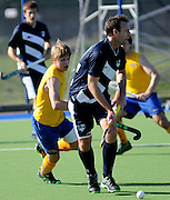 Ryan Archibald in control for Auckland. 2014 Ford National Hockey League. Southern v  Auckland at Alexander McMillan Hockey Centre, Dunedin, New Zealand. Saturday 30 August 2014. New Zealand. Photo: Richard Hood/photosport.co.nz