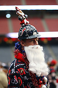A fan dresses up in a Christmas costume prior to the Houston Texans NFL football game against the Seattle Seahawks on December 13, 2009 in Houston, Texas. ©Paul Anthony Spinelli