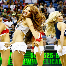 Oct 23, 2013; New Orleans, LA, USA; The New Orleans Pelicans dance team performs during the first half of a preseason game against the Miami Heat at New Orleans Arena.  The Heat defeated the Pelicans 108-95. Mandatory Credit: Derick E. Hingle-USA TODAY Sports