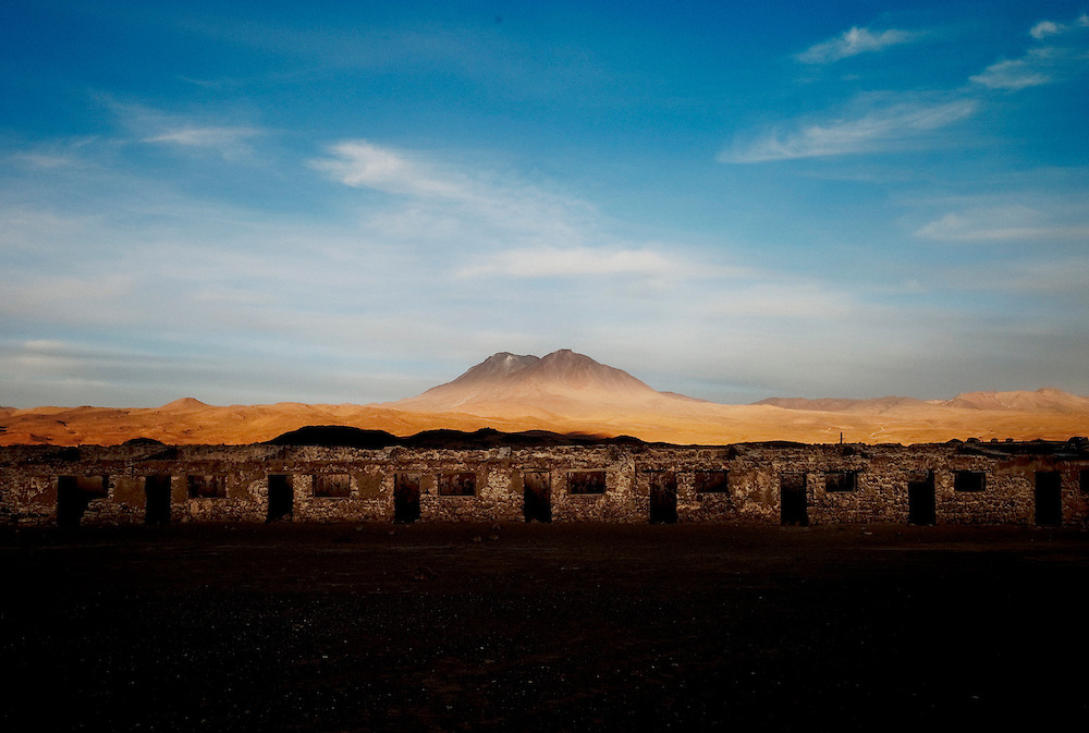 """The remains of Buenaventur mining town in the higlands near the border with Bolivia, and Aucanquilcha volcano in the background. All the Atacama desert is littered with abandoned mining towns,  a reminder of the ephemeral of """"gold"""" rushes and what is coming next after the water is gone. November 2009."""